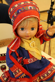 A doll dressed in Lappish Costume is a dear friend of an adult lady.